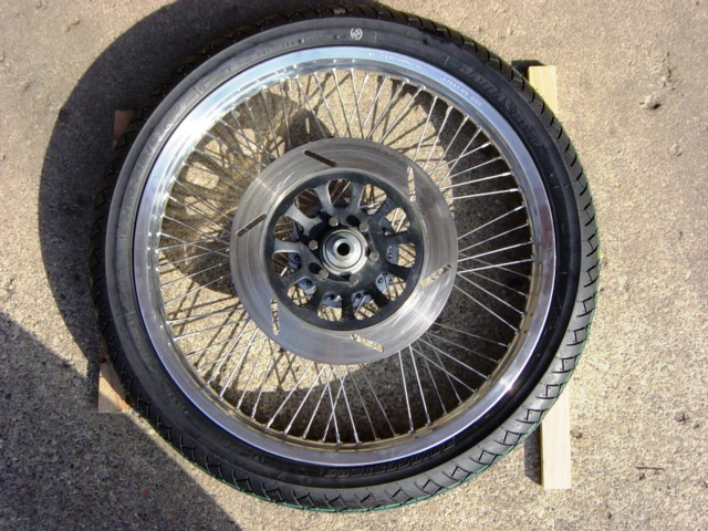 21 inch rim and tire.JPG