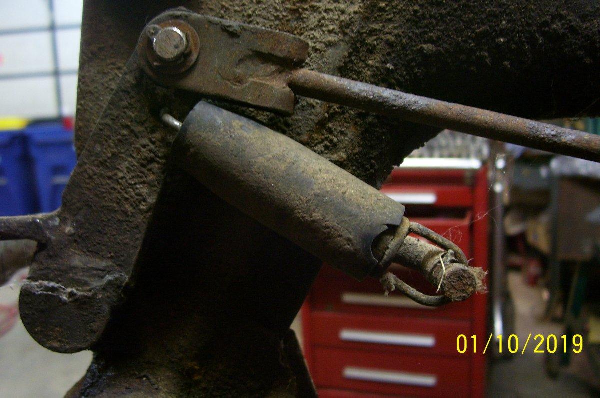 Back side of linkage spring holding up lever.JPG